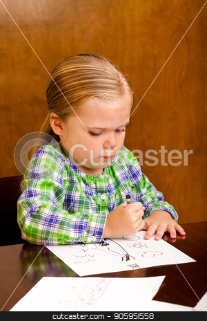 Hard at work on trying to impress mommy stock photo, Young girl is drawing a picture for mommy  by txking