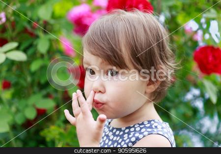 Cute little toddler girl picking her nose stock photo, Cute little toddler girl picking her nose. by Alfira Poyarkova