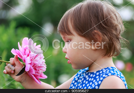 Adorable little girl sniffing purple flowers. stock photo, Adorable little girl sniffing purple flowers. Child and flowers, summer, nature and fun. Summer holidays. by Alfira Poyarkova