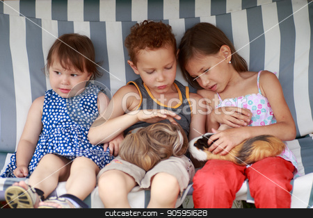 three children are sitting in a hammock and playing her guinea pig pet animal stock photo, three children are sitting in a hammock and playing her guinea pig pet animal. by Alfira Poyarkova