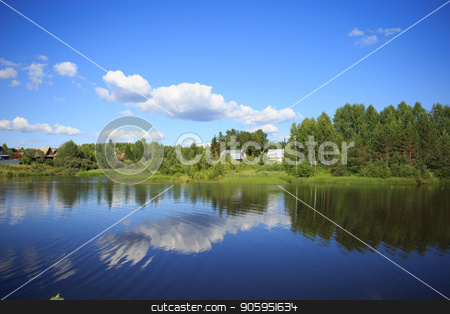 Lake reflecting sky with clouds on it flowing through a small village stock photo, Lake reflecting sky with clouds on it flowing through a small village and covering banks with trees, shrubs and plants growing on them by Alfira Poyarkova