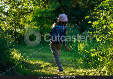 Traveler girl with backpack walking on path in the tropical forest stock photo, Traveler young girl with backpack walking on path in the tropical forest by Alfira Poyarkova