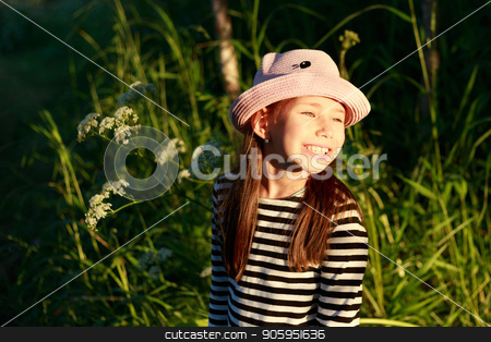 A cute little happy girl in the forest on a sunny summer day stock photo, A cute little happy girl in the forest on a sunny summer day. by Alfira Poyarkova