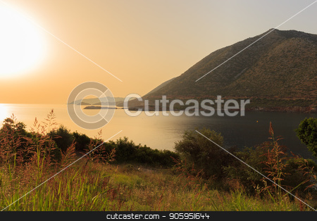 Greece. Crete. The Bay at sunset. stock photo, Greece Crete. The Bay at sunset Golden sun by Alfira Poyarkova
