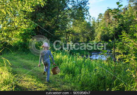 Young girl walking on a path through green woods carrying a basket stock photo, Young girl walking on a path through green woods carrying a birchbark basket by Alfira Poyarkova
