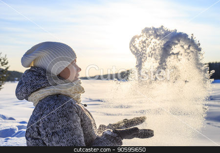 Pretty woman with knitted hat and scarf throws snow at sunny winter day stock photo, Pretty woman with knitted hat and scarf throws snow at sunny winter day. by Alfira Poyarkova