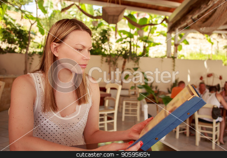 Happy woman in cafe with menu. Beautiful vacation woman in restaurant at dinner. stock photo, Happy woman in cafe with menu. Beautiful vacation woman in restaurant at dinner. Greece, Bali. by Alfira Poyarkova