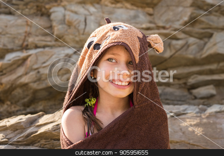White sailboat in the open sea. Sailing yacht in the open sea with mountains in the background. stock photo, a girl covered with the beach towel in the form of the bear skin near the rock by Alfira Poyarkova