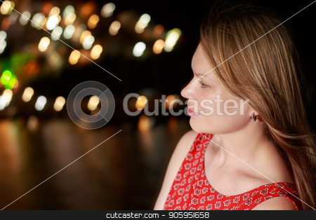 Night street portrait of beautiful woman on the background of the sea Bay stock photo, Night street portrait of beautiful woman on the background of the sea Bay. by Alfira Poyarkova