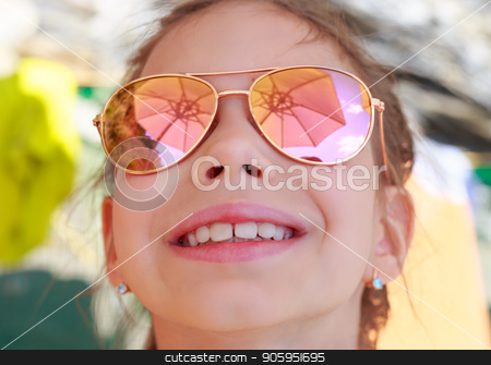 Beautiful young girl in sunglasses with beach umbrella reflection. stock photo, Beautiful young girl in sunglasses with beach umbrella reflection. Holidays, travel, vacation and happiness concept. by Alfira Poyarkova