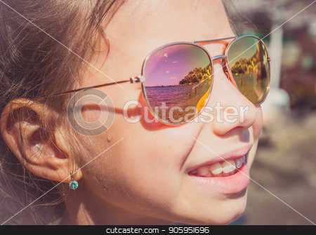 Beautiful young girl in sunglasses with beach reflection. stock photo, Beautiful young girl in sunglasses with beach reflection. Holidays, travel, vacation and happiness concept. by Alfira Poyarkova