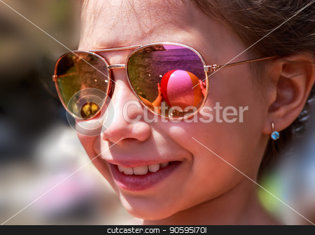 Beautiful young girl in sunglasses with beach ball rerlection. stock photo, Beautiful young girl in sunglasses with beach ball rerlection. rerlection Holidays, travel, vacation and happiness concept. by Alfira Poyarkova