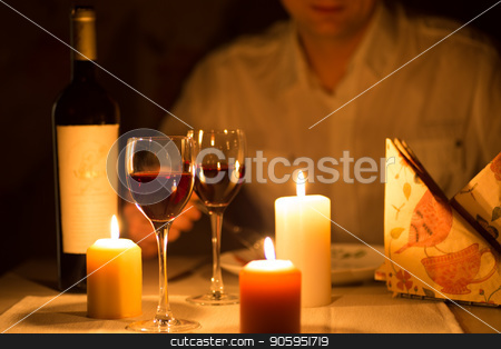 Romantic dinner with candles and wine stock photo, Romantic dinner with candles and wine by Alfira Poyarkova