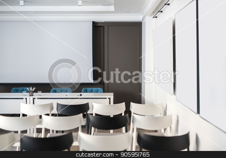 Modern conference hall stock photo, Comfortable conference hall with white walls. There are many light and dark chairs, board, tables with blue soft chairs, lamps. Horizontal. by bezikus