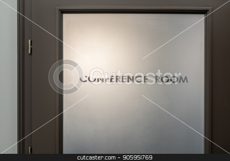Entrance door to conference room stock photo, Brown frosted door with an inscription