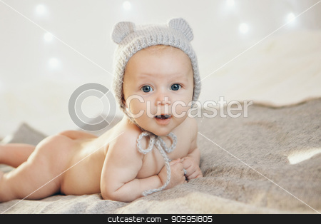 naked newborn baby lying on his tummy in a knitted hat. Little boy on white background stock photo, naked newborn baby lying on his tummy in a knitted hat. Little boy on white background by aaalll3110