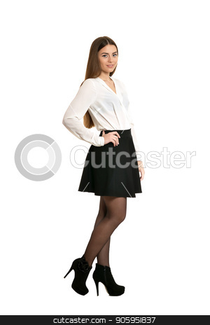 Young beautiful woman  stock photo, Young beautiful woman in black skirt and heels standing full length, isolated on white background by Ruslan Huzau
