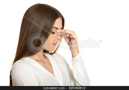 Beautiful woman with headache stock photo, Beautiful woman in white blouse with headache on white background by Ruslan Huzau