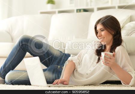 beautiful woman using  laptop stock photo, young beautiful woman using  laptop  at home by Ruslan Huzau