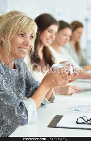 women  working in office  stock photo, Portrait of beautiful business women working in office by Ruslan Huzau