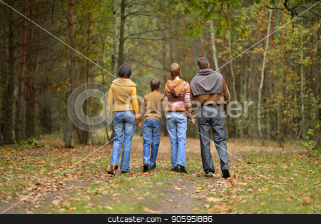 Family of four in park stock photo, Happy family of four walking in the park in autumn by Ruslan Huzau