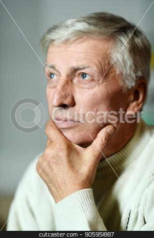 Thoughtful elderly man stock photo, Intelligent elderly man thinking on gray background by Ruslan Huzau