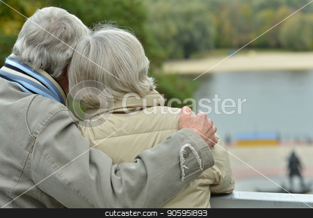 Senior couple  in park, back view stock photo, happy Senior couple  in park, back view by Ruslan Huzau