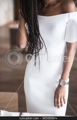 Close-up shot of beautiful white dress on afroamerican woman. stock photo, Close-up shot of beautiful white dress on afroamerican woman. by Andrii Kobryn