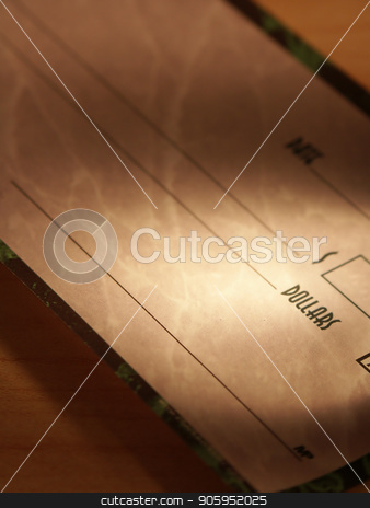 Dollar check book stock photo, Dollar check book on a table by Bruce Rolff