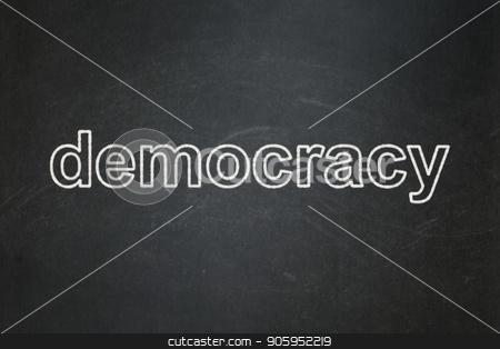 Political concept: Democracy on chalkboard background stock photo, Political concept: text Democracy on Black chalkboard background by mkabakov