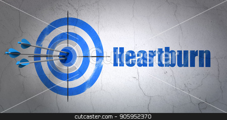 Health concept: target and Heartburn on wall background stock photo, Success Health concept: arrows hitting the center of target, Blue Heartburn on wall background, 3D rendering by mkabakov