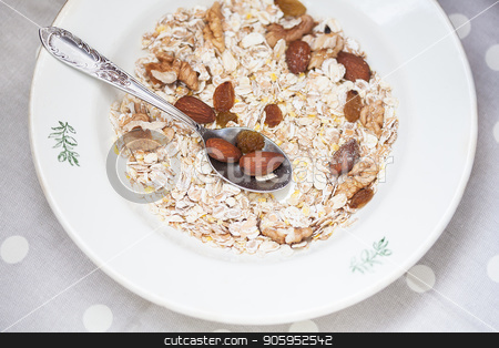 Oatmeal in bowl with nuts, useful food stock photo, Oatmeal in bowl with nuts, useful food. by Sergiy Artsaba
