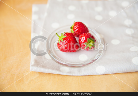 strawberries in a glass bowl on a wooden background and a beige napkin peas stock photo, strawberries in a glass bowl on a wooden background and a beige napkin peas. by Sergiy Artsaba