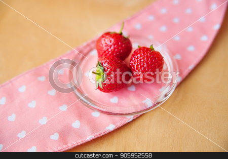 strawberries in a glass bowl on a wooden background and pink napkin stock photo, strawberries in a glass bowl on a wooden background and pink napkin. by Sergiy Artsaba