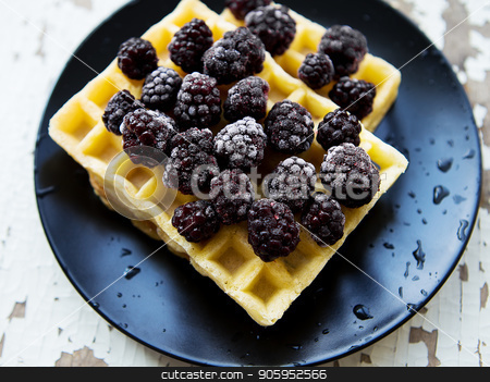 Belgian waffles with blackberry on an old wooden table stock photo, Belgian waffles with blackberry on an old wooden table. by Sergiy Artsaba