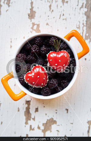 A full blackboy plate with a dessert in the form of a heart stands on a wooden background, close-up stock photo, A full blackboy plate with a dessert in the form of a heart stands on a wooden background, close-up. by Sergiy Artsaba
