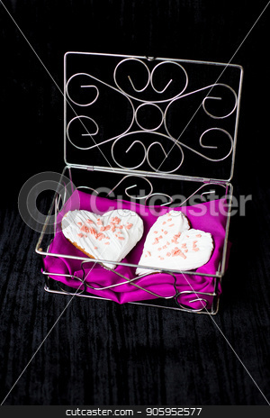 Cookies in the form of heart lies in a casket with pink cloth stock photo, Cookies in the form of heart lies in a casket with pink cloth. by Sergiy Artsaba