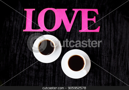 two cups of coffee on pink background inscription love Valentine's Day stock photo, two cups of coffee on pink background inscription love Valentine's Day. by Sergiy Artsaba