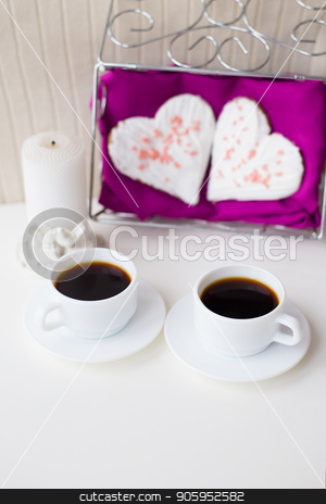 two cups of coffee, cookies and candle in the form of heart on a pink napkin stock photo, two cups of coffee, cookies and candle in the form of heart on a pink napkin. by Sergiy Artsaba