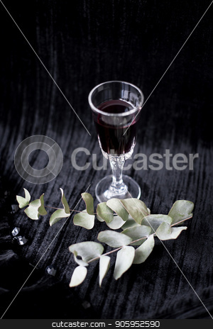twig and glass of red wine on a black background Velvet stock photo, twig and glass of red wine on a black background Velvet. by Sergiy Artsaba