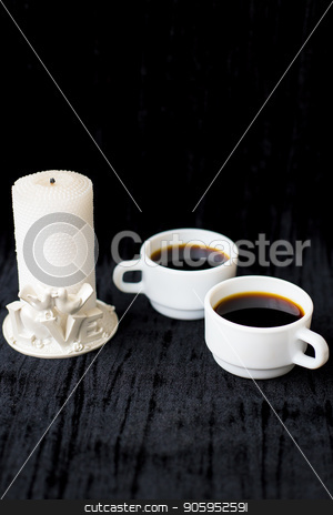 candle and two cups of coffee on a black background stock photo, candle and two cups of coffee on a black background. by Sergiy Artsaba