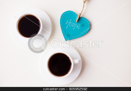 two cups of coffee on the table that says home stock photo, two cups of coffee on the table that says home. by Sergiy Artsaba