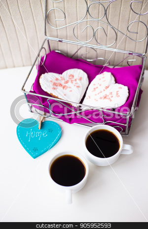 Cookies in a heart and two cups of coffee on the table that says home stock photo, Cookies in a heart and two cups of coffee on the table that says home. by Sergiy Artsaba