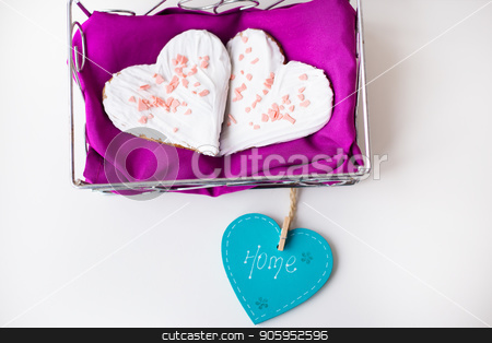 Cookies in the form of heart on a pink napkin inscription home stock photo, Cookies in the form of heart on a pink napkin inscription home. by Sergiy Artsaba