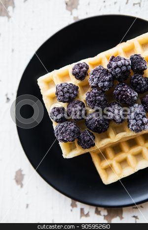 Delicious and beautiful Belgian waffles with blackberries stock photo, Delicious and beautiful Belgian waffles with blackberries. by Sergiy Artsaba
