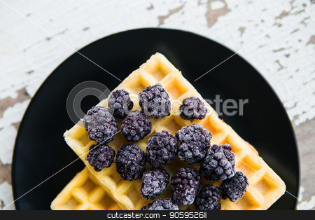 Delicious and beautiful Belgian waffles with blackberries, close-up stock photo, Delicious and beautiful Belgian waffles with blackberries, close-up. by Sergiy Artsaba