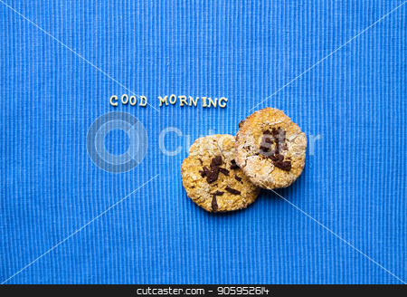 oatmeal cookies on a blue napkin that says good morning stock photo, oatmeal cookies on a blue napkin that says good morning. by Sergiy Artsaba
