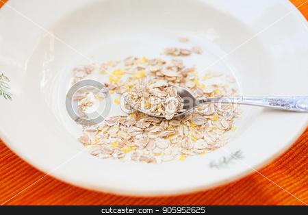 oatmeal in white bowl on orange napkin stock photo, oatmeal in white bowl on orange napkin. by Sergiy Artsaba