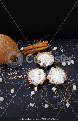 coconut muffins on a black background stock photo, coconut muffins on a black background inscription love coconuts, close-up by Sergiy Artsaba