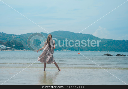 handsome girl on the beach background. Portrait of a woman in white clothes on the sea stock photo, handsome girl on the beach background. Portrait of a woman in white clothes on the sea by aaalll3110